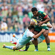 Manusamoa Tuilagi of Leicester Tigers (right) is tackled by Adam Powell of Newcastle Falcons (left) during the Aviva Premiership match at Welford Road, Leicester<br /> Picture by Andy Kearns/Focus Images Ltd 0781 864 4264<br /> 06/09/2014