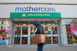 © licensed to London News Pictures. London, UK 12/04/2012. A woman walking past a shop Mothercare this morning in Wood Green (12/04/12). Mothercare expected to be shutting 111 stores with 700 job losses. Photo credit: Tolga Akmen/LNP