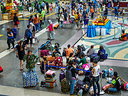 11 APRIL 2018 - BANGKOK, THAILAND:  Hua Lamphong train station in Bangkok on the first day of the Songkran travel period. Songkran is the traditional Thai New Year and is one of the busiest travel periods of the year as Thais leave the capital and go back to their home provinces or resorts in tourist areas. Trains and busses are typically jammed the day before the three day Songkran holiday starts. The government has extended the official holiday period through Monday, 16 April because one day of the Songkran holiday fell on the weekend, giving many workers a five day holiday.     PHOTO BY JACK KURTZ