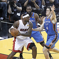 21 June 2012: Miami Heat small forward LeBron James (6) is double teamed by Oklahoma City Thunder guard James Harden (13) and Oklahoma City Thunder power forward Nick Collison (4) during the Miami Heat 121-106 victory over the Oklahoma City Thunder, in Game 5 of the 2012 NBA Finals, at the AmericanAirlinesArena, Miami, Florida, USA. The Miami Heat wins the series 4-1.