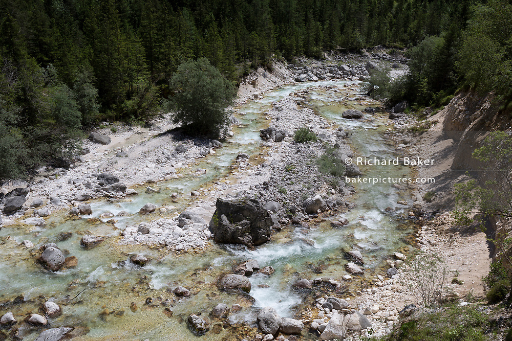 The Soca River amid some of the highest peaks in Slovenia in the Triglavski Narodni Park, on 22nd June 2018, in Trenta, Triglav National Park, Slovenia. Nearby mountains are Kreiski 2050m, Pihavec 2419m, Dolina Zadnjica and Triglav 2864m.