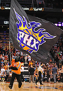 Apr. 11, 2011; Phoenix, AZ, USA; Phoenix Suns Gorilla runs the Phoenix Suns flag across the court during a game against the Minnesota Timberwolves at the US Airways Center. The Suns defeated the Timberwolves 135 -127 in overtime. Mandatory Credit: Jennifer Stewart-US PRESSWIRE.