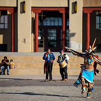 Raydean Johnson performs an eagle dance in a performance with the Cellicion Zuni Dancers during the Nightly Indian Dances at the McKinley Courthouse Plaza in Gallup Monday.