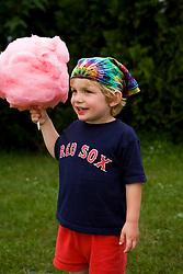 A young boy enjoying cotton candy at the Quechee Balloon Festival Vermont USA (MR)