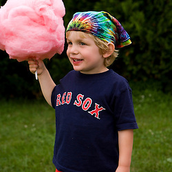 A young boy enjoying cotton candy at the Quechee Balloon Festival Vermont USA (MR)