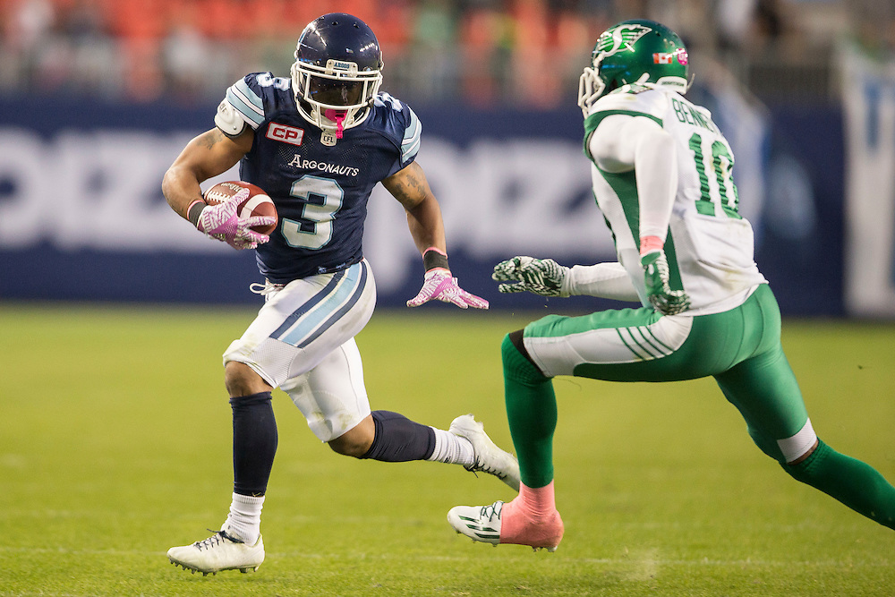 Toronto's Brandon Whitaker tries to avoid a tackle from Fred Bennett  of the Saskatchewan Roughriders during 4th quarter CFL action at BMO Field in Toronto on Saturday, October 15, 2016.  (CFL PHOTO - Geoff Robins)