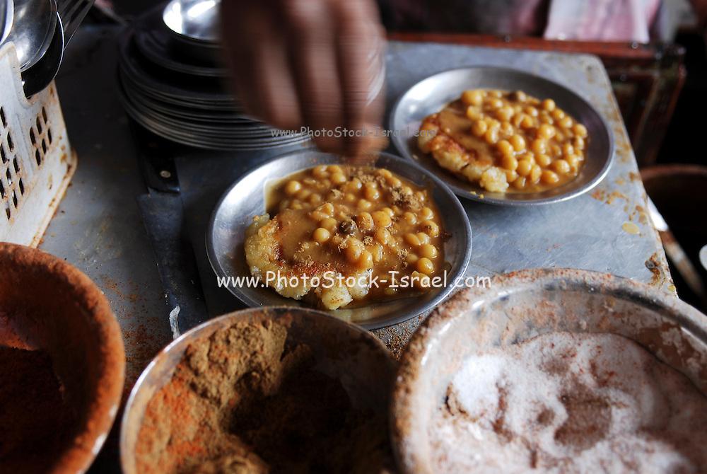India, street vendor sells food