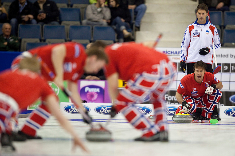 Norway's skip Thomas Ulsrud shouts directions to his teammates during Norway's tie breaker against France at the Ford World Men's Curling Championships in Regina, Saskatchewan, April 8, 2011.<br /> AFP PHOTO/Geoff Robins
