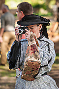 A Civil War historic living history re-enactor takes a picture with a modern digital camera at the Battle of Secessionville at Boone Hall Plantation November 9, 2008 in Mount Pleasant, SC.  The battle recreates the defeat of Union forces in 1862 in the only attempt to capture Charleston during the Civil War.