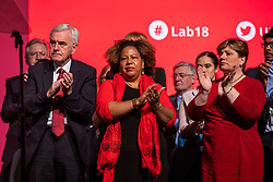 © Licensed to London News Pictures. 26/09/2018. Liverpool, UK. Shadow Chancellor John McDonnell MP (L) and Shadow Foreign Secretary Emily Thornberry MP (R) on stage during Jeremy Corbyn's closing speech at the Labour Party Conference. Photo credit: Rob Pinney/LNP