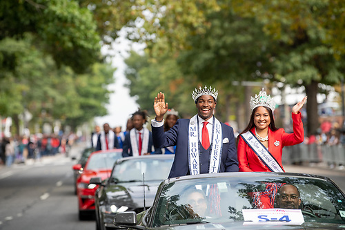 Mr. and Miss Howard University wave from their car at the Homecoming Parade.