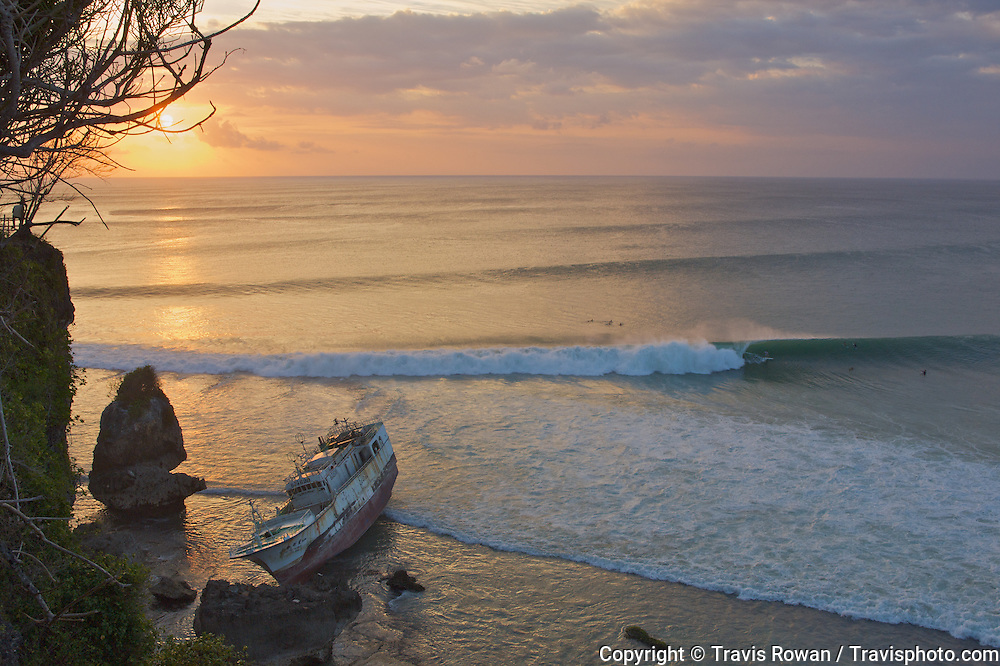 A fishing boat shipwrecked on a reef at one of Bali's finest surf breaks.