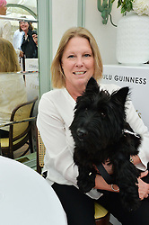 VISCOUNTESS GORMANSTON and her dog Otis at a party hosted by Lulu Guinness and Daphne's to launch Lulu's Designer Dog Bowl and to mark Daphne's allowing dogs through it's doors, held at Daphne's, Draycott Avenue, London on 28th June 2016.