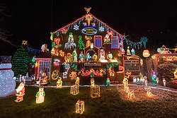 © Licensed to London News Pictures. 01/12/2019. Bristol, UK. The Brailsford family switch on the Christmas lights on their family home in Trevisa Grove. It started in 1994 when brothers Paul and Lee Brailsford were teenagers and has now become a festive highlight in the name of raising money for one of Bristol's most loved charities, Wallace & Gromit's Grand Appeal which supports sick children and their families at Bristol Children's Hospital. The Brailsford's lights are recognised as one of the largest private Christmas lights displays in the UK, the family has so far raised £68,000 from generous public donations for the Bristol Children's Hospital charity. The spectacle of over 50,000 Christmas lights takes six weeks to build and boasts 15 Santas, 10 reindeer, 10 snowmen, 50 rope-light shapes, trains, elves and a life-size nativity powered by 100,000 LED lights. The house will light up every night until Thursday 2 January 2020 from 5pm to 10pm. Wallace & Gromit's Grand Appeal is the dedicated Bristol Children's Hospital charity. It runs a multi-million-pound portfolio of investment in partnership with the children's hospital and its Neonatal Intensive Care Unit at St Michael's Hospital, Bristol. Photo credit: Simon Chapman/LNP.