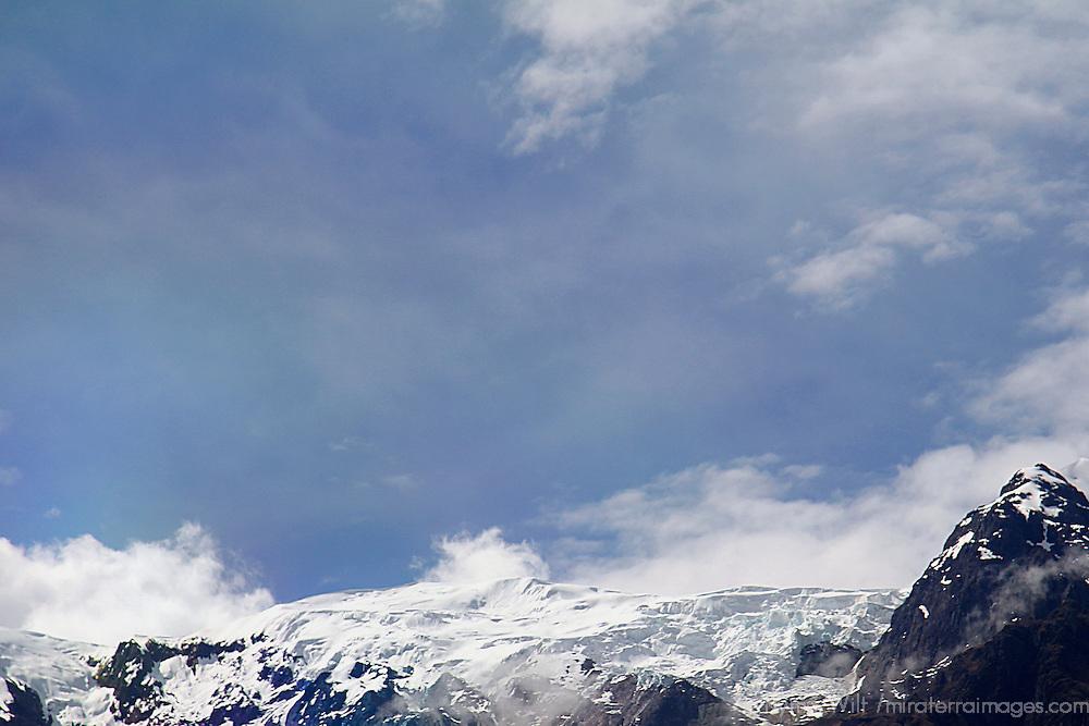 South America, Peru, Urubamba. Andean Peaks and clouds.