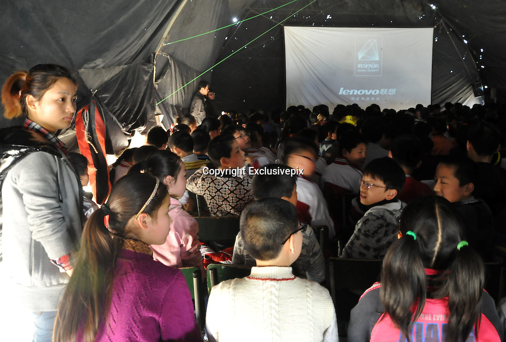"""ZHANGZHOU, CHINA - (CHINA OUT) <br /> <br /> """"Movie Theater"""" In Rural China <br /> <br /> Villagers watch outdoor movies in a big tent at Yuantong village in Chaohu, Anhui Province of China. There are many movie projectionists working in rural areas to show movies for farmers.<br /> ©Exclusivepix"""