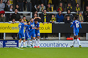 Peterborough players celebrate going one goal up during the The FA Cup match between Burton Albion and Peterborough United at the Pirelli Stadium, Burton upon Trent, England on 7 November 2015. Photo by Aaron Lupton.
