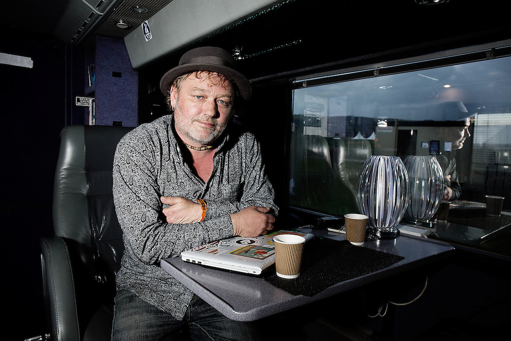 Mark Chadwick  frontman of the Levellers on his tour bus May 30, 2014 backstage at Wychwood festival<br /> photos by Ki Price