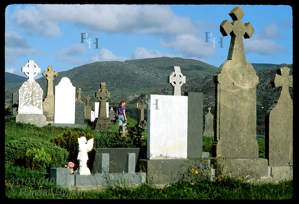 American tourist, Colette Ogle, walks through Kilcatherine cemetery on the Beara Peninsula, Ireland.