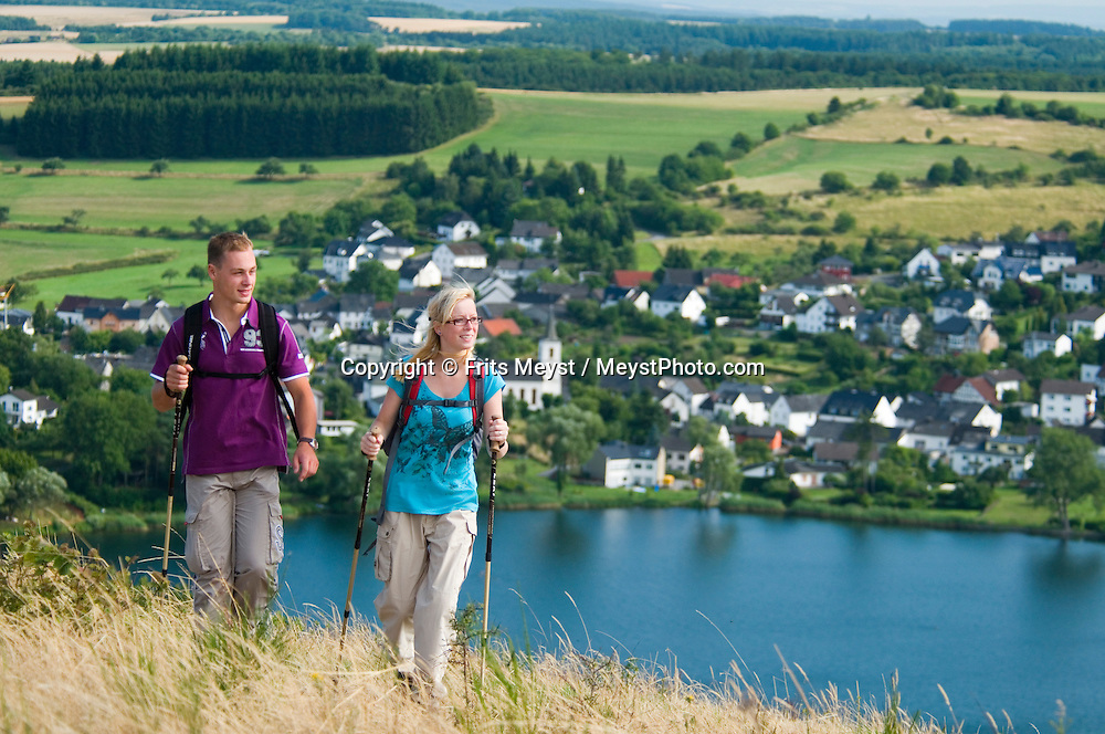 """Eifel, Germany, August 2010. There are 74 volcanic lakes in the Eifel, called a 'Maar' From the flat north near Aachen, over the """"Hohes Venn"""" (or """"High Fen""""), through the lonesome Rurtal, past imposing dams, the """"Eifel National Park"""" and over the lime Eifel and Vulkaneifel to the Southern Eifel, the Eifelsteig passes through a wide variety of areas, constantly revealing new landscapes to hikers. 313 kilometres of the Eifelsteig - a good 300 kilometres of varied, natural tracks, with a large number of bare paths, magnificent views, and a variety of different formations. Photo by Frits Meyst/Adventure4ever.com"""
