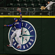 Mariners DH Nelson Cruz hits a home run that Texas center fielder Ian Desmond, pictured, can't catch, but fan -- at right -- can, in eighth inning, Monday, April 11, 2016, at Safeco Field in Seattle.<br />