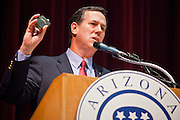 21 FEBRUARY 2012 - PHOENIX, AZ:  Former US Senator and Republican Presidential candidate RICK SANTORUM holds up a copy of the US Constitution while he speaks at the Maricopa County Lincoln Day lunch in Phoenix. Santorum was in Phoenix Tuesday for an Arizona Republican party leadership luncheon ahead of the state's Republican Presidential Primary election and a CNN Republican Presidential Primary debate, which is Wednesday, Feb. 22.  PHOTO BY JACK KURTZ