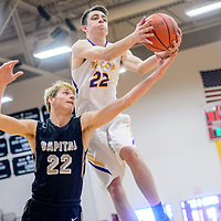 Kirtland Central Bronco Jaben Haws (22), right, grabs a rebound above Capital Jaguar Matt Smith (22) during the Eddie Peña Invitational basketball tournament in Grants Thursday.