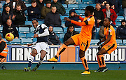 Millwall FC Defender Shaun Cummings plays a dangerous seeking ball across the during the Sky Bet League 1 match between Millwall and Colchester United at The Den, London, England on 21 November 2015. Photo by Andy Walter.