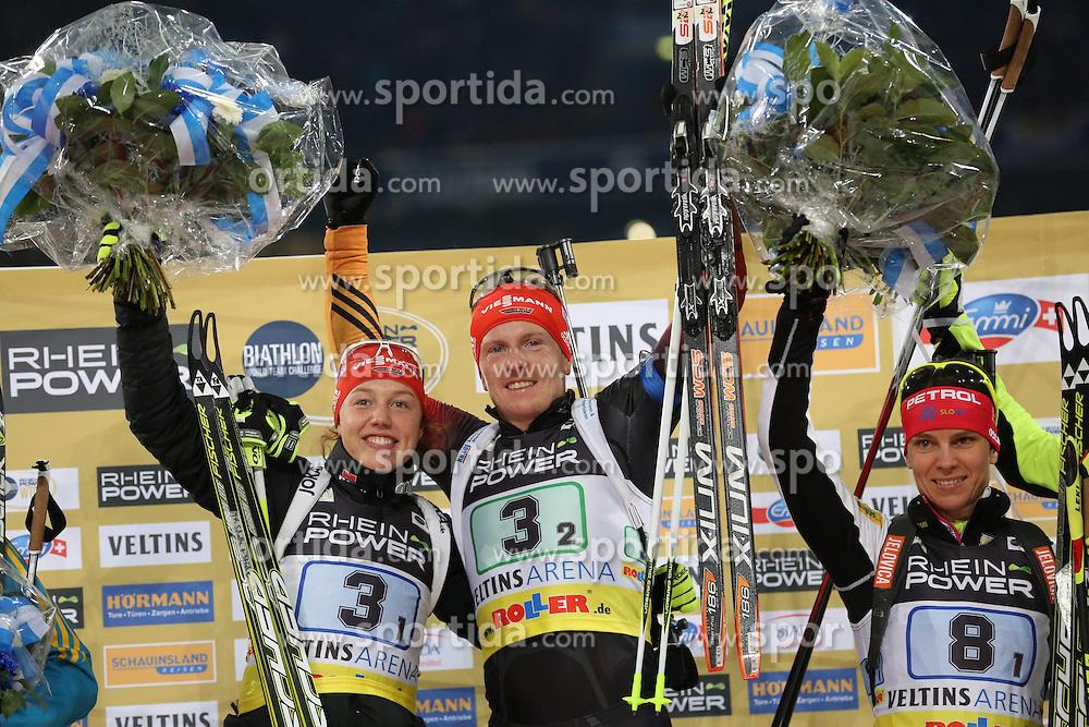 28.12.2013, Veltins Arena, Gelsenkirchen, GER, IBU Biathlon, Biathlon World Team Challenge 2013, im Bild Laura Dahlmeier (Deutschland / Germany), Florian Graf (Deutschland / Germany) jubeln waehrend der Siegerehrung, freuen sich, celebrating, Emtotion, Freude, Glueck, Luck // during the IBU Biathlon World Team Challenge 2013 at the Veltins Arena in Gelsenkirchen, Germany on 2013/12/28. EXPA Pictures &copy; 2013, PhotoCredit: EXPA/ Eibner-Pressefoto/ Schueler<br /> <br /> *****ATTENTION - OUT of GER*****