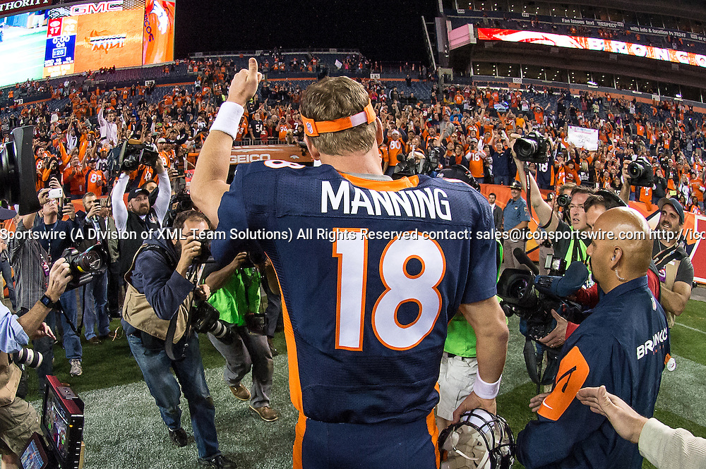 19 October 2014: Denver Broncos Quarterback Peyton Manning (18) [2982] celebrates with fans and players after setting the new NFL record for throwing the most career touchdown passes at 509 in action during a game between the San Francisco 49ers and the Denver Broncos at Sports Authority Field at Mile High, in Denver, CO.