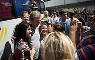 England manager Roy Hodgson is mobbed by fans as the team depart from the Blue Tree Premium hotel for a tour of Manaus ahead of the England open training session at Arena da Amazonia, Manaus, Brazil.  Hodgson purposefully went straight to the fans and spent about 10 minutes getting his picture taken, signing autographs and being generally very approachable and very good humoured. The mainly Brazilian crowd were extremely enthusiastic.<br /> Picture by Andrew Tobin/Focus Images Ltd +44 7710 761829<br /> 13/06/2014