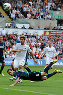 Sunderland's Craig Gardner (8) blocks a late shot from Swansea's Danny Graham ©.  Barclays Premier league, Swansea city v Sunderland at the Liberty Stadium in Swansea, South Wales on Saturday 1st Sept 2012. pic by Andrew Orchard, Andrew Orchard sports photography,