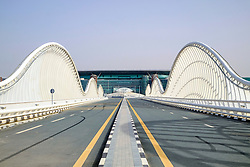 Modern highway bridge at approach to Meydan racecourse in Dubai United Arab Emirates