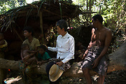 A Maniq group receives a visit from representatives of the National Human Rights Commission of Thailand who spent 3 days visiting various groups to discuss the future of their citizenship, something which only 20% now have.<br /> <br /> Evidence suggests that the Maniq, a Negrito tribe of hunters and gatherers, have inhabited the Malay Peninsula for around 25,000 years. Today a population of approximately 350 maniq remain, marooned on a forest covered mountain range in Southern Thailand. Whilst some have left their traditional life forming small villages, the majority still live the way they have for millennia, moving around the forest following food sources. <br /> <br /> Quiet and reclusive they are little known even in Thailand itself but due to rapid deforestation they are finding it harder to survive on the forest alone and are slowly being forced to move to its peripheries closer to Thai communities.