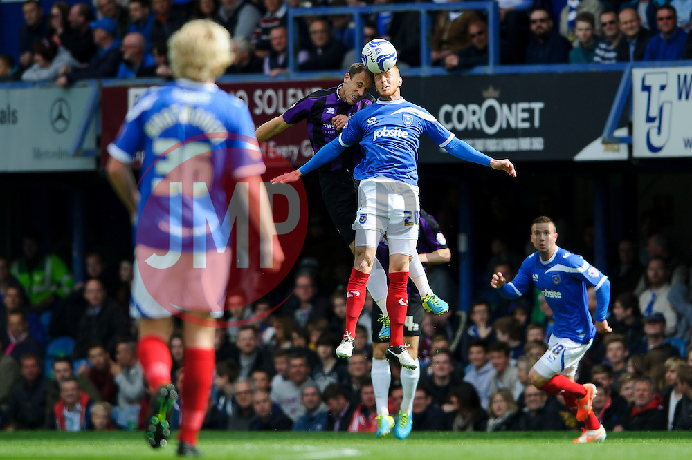 Mark McChrystal (NIR) of Bristol Rovers and Ryan Taylor (ENG) of Portsmouth compete in the air - Photo mandatory by-line: Rogan Thomson/JMP - 07966 386802 - 19/04/2014 - SPORT - FOOTBALL - Fratton Park, Portsmouth - Portsmouth FC v Bristol Rovers - Sky Bet Football League 2.