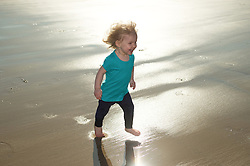 © Licensed to London News Pictures. 28/03/2012..Saltburn, England..As temperatures rise this week the beach at Saltburn in Cleveland attracts the visitors as they enjoy the warm weather. Hannah Cuthbert, 18 months from Stockton plays on the beach...Photo credit : Ian Forsyth/LNP