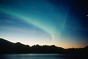 Alaska. Cordova. Aurora borealis or northern lights from the Million Dollar Bridge on the Copper River Hwy.
