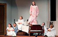 "During a thunderstorm Grace McLaughlin as Maria Rainer teaches the Von Trapp children to ""simply remember their favorite things"" .... and then they ""don't feel so bad"" during dress rehearsal for The Sound of Music Wednesday evening at Gilford High School.  (Karen Bobotas/for the Laconia Daily Sun)"