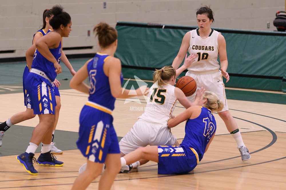 2nd year forward Alexi Rowden (15) and 5th year forward Ainsley MacIntyre (10) scramble for the ball during the Women's Basketball Preseason game on October 14 at Centre for Kinesiology, Health and Sport. Credit: Arthur Ward/Arthur Images