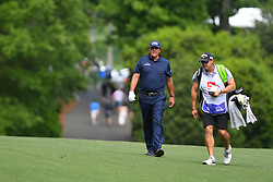 May 3, 2019 - Charlotte, NC, U.S. - CHARLOTTE, NC - MAY 03: Phil Mickelson walks along side his caddie on the 11th fairway during round two of the Wells Fargo Championship on May 03, 2019 at Quail Hollow Club in Charlotte,NC. (Photo by Dannie Walls/Icon Sportswire) (Credit Image: © Dannie Walls/Icon SMI via ZUMA Press)