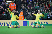 Norwich City midfielder Nelson Oliveira celebrates his hat trick with Norwich City midfielder Jonathan Howson during  the EFL Sky Bet Championship match between Norwich City and Derby County at Carrow Road, Norwich, England on 2 January 2017. Photo by Nigel Cole.