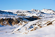 Typical Icelandic landscape of snow-covered mountains  in South Iceland