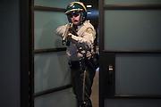 Nightwatch patrolman at doorway with rifle