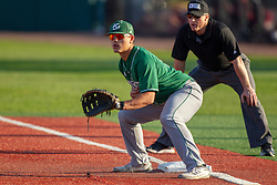 NORMAL, IL - April 08: Umpire Rick Allen watches a throw to first baseman Martin Vincelli-Simard during a college baseball game between the ISU Redbirds  and the Sacramento State Hornets on April 08 2019 at Duffy Bass Field in Normal, IL. (Photo by Alan Look)