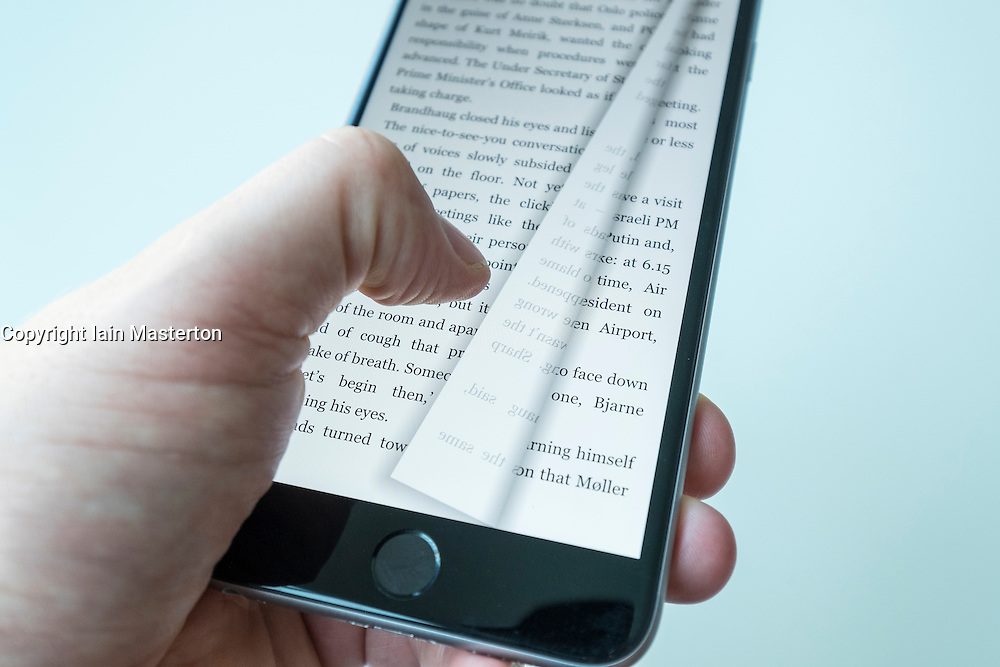 Reading an e-book on an iPhone 6 Plus smart phone