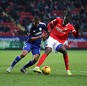 Charlton Athletic striker, Yaya Sanogo (25) battles for possesion with Cardiff City defender, Lee Peltier (2) during the Sky Bet Championship match between Charlton Athletic and Cardiff City at The Valley, London, England on 13 February 2016. Photo by Matthew Redman.
