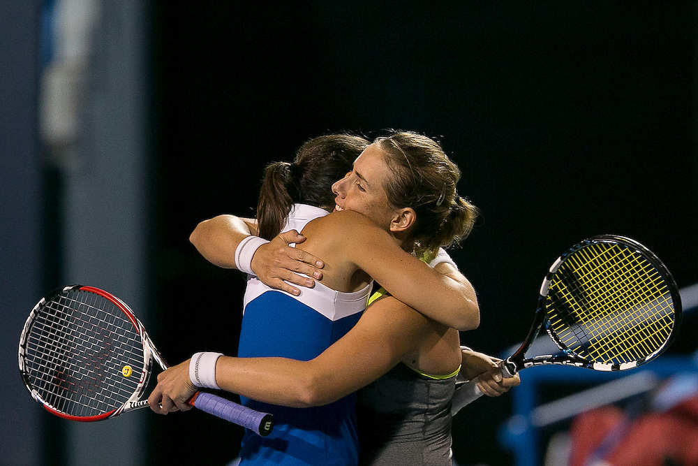 August 22, 2014, New Haven, CT:<br /> Marina Erakovic and Arantxa Parra Santonja hug after winning the women's doubles semi-finals against Monica Niculescu and Caroline Garcia on day eight of the 2014 Connecticut Open at the Yale University Tennis Center in New Haven, Connecticut Friday, August 22, 2014.<br /> (Photo by Billie Weiss/Connecticut Open)