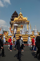 © Licensed to London News Pictures. 01/02/2013. Location, Cambodia. The coffin of  Late former King Norodom Sihanouk passes the Independence Monument as part of the royal funeral procession ahead of his Feb. 4, cremation Friday, Feb. 1, 2013, in Phnom Penh, Cambodia.  Photo credit : Charles Fox/LNP