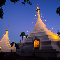 Wat Phra That Doi Kong Mu temple glows under azure skies at sunset, Mae Hong Son, Thailand