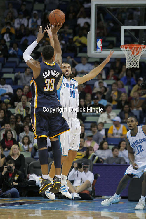 Oct 17, 2009; New Orleans, LA, USA; Indiana Pacers forward Danny Granger (33) shoots a three pointer over New Orleans Hornets forward Peja Stojakovic (16) during the first half at the New Orleans Arena. Mandatory Credit: Derick E. Hingle-US PRESSWIRE